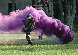 Smoke grenade - A violet smoke grenade being used during a military training exercise