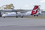 "QantasLink (VH-SBB) Bombardier DHC-8-315Q Dash 8, in new QantasLink ""new roo"" livery, taxiing at Wagga Wagga Airport.jpg"