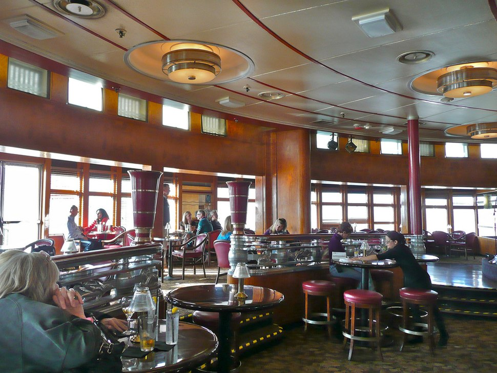Observation Bar lounge. The windows were once part of the enclosed Promenade Deck turnaround; the lounge was extended forward after 1967.