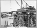 Queensland State Archives 3600 Main bridge erection stage 2 placing lower chord pin on east main bearing Brisbane 8 October 1937.png