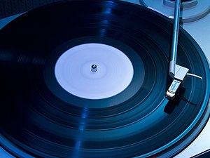 Album - An LP record album on a phonograph turntable