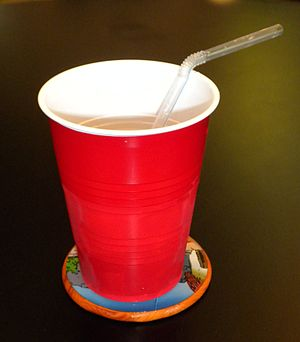Plastic cup - A red plastic cup with a drinking straw
