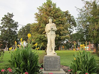 "Minden, Louisiana - Statue of a Confederate soldier at the western end of Jacqueline Park in Minden near the point where Main and Broadway streets turn into the Shreveport Road. The caption concludes with ""Lest We Forget"" engraved twice."