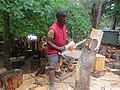 Right Mukore carving a tree into a woman lifting a heart at Montebello Bibiloucapetown Essay Photo 4.jpg