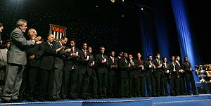 An association football team being congratulated by delegates from São Paulo.
