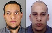 Photographie en couleur représentant deux hommes arabes ayant entre vingt et trente ans, cheveux courts et barbe courte pour l'un, crâne rasé et visage glabre pour l'autre