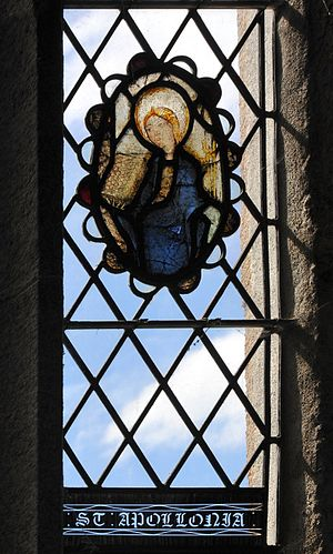 Kingskerswell - Stained glass image of Saint Apollonia in St Mary's Church
