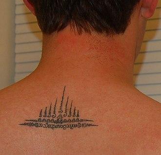 Yantra tattooing - A simple sak yan nine spire (kao yot) tattoo