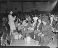 Salinas, California. Seated in family groups, evacuees of Japanese ancestry check in at Armory befo . . . - NARA - 536190.tif
