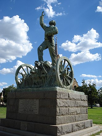 Kroonstad - The Sarel Cilliers memorial in the grounds of the NG Moederkerk, Kroonstad. Cilliers is depicted standing on a gun carriage, making the Blood River vow.