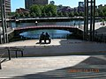 Seated people statue at Canary Wharf.jpg