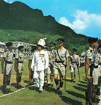 Colonial Governor of the Seychelles inspecting police guard of honour in 1972 Seychelles Governor inspection 1972.jpg