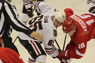Andrew Shaw (ice hockey) - Shaw (left) tries to win a face-off against Joakim Andersson in 2014.