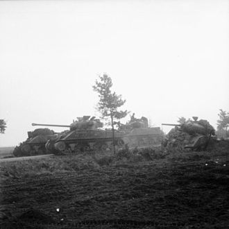 Brian Horrocks - A Sherman Firefly passes knocked-out British tanks, 17 September 1944. Horrocks' XXX Corps had to advance along a single raised road. This made it easy for German gunners to knock out the leading vehicles, causing delays.
