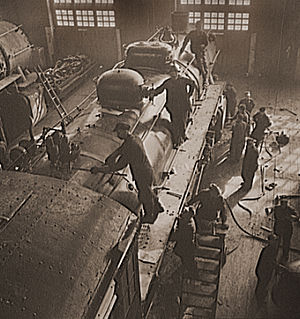 Railroad shopmen - Shopmen overhauling a locomotive on the Chicago and Northwestern Railroad, 1942.
