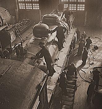Railroad shopmen - Shopmen overhauling a locomotive on the Chicago and Northwestern Railroad, 1942.