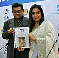 Shri Amit Kumar, son of the Legendary film personality late Kishore Kumar and Ms. Anooradha Patel (Grand daughter of Dadasaheb Phalke Awardee late Ashok Kumar) showing a painting by Ashok Kumar.jpg