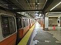 Southbound Orange Line train at North Station (1), July 2019.JPG