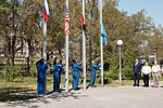 Soyuz MS-15 prime and backup crews raise flags at the Cosmonaut Hotel.jpg