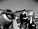 Station Agent and Two Models in front of Lockheed 10B Electra, Delta Air Lines (11429589593).jpg
