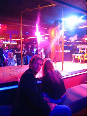 Strip Club Customers Seated at Tip Rail