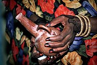 Henna painting hands and Jabana (coffee can)