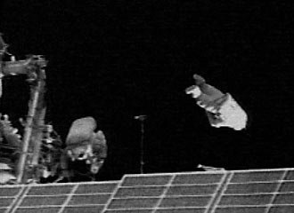 SuitSat - Launch of SuitSat-1 (left to right: Astronaut, SuitSat)