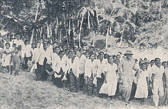 Moluccans - Sukarno dancing with Moluccan people, 1958.