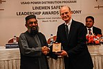 Syed Shafqat Hussain Receiving an Award from USAID Energy Office Director Michael Curtis. (13263868494).jpg