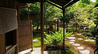 Roji - Roji with the Nijiriguchi (Entrance) to the tea house at the Adachi Museum of Art, Yasugi, Shimane Prefecture, Japan.