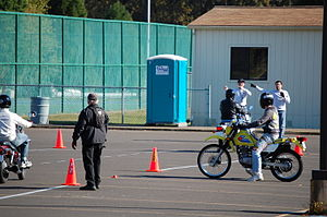 Motorcycle training - A motorcyclist receives verbal instructions