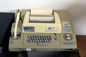 Teletype Model 33 - A Model 32 used for Telex service. Note the three row keyboard and narrower, five-level paper tape.