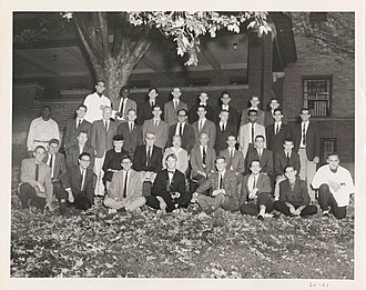 Telluride House - House membership in the fall of 1960. Among those pictured are Frances Perkins (the House's first female resident), Abram Shulsky, George Sabine, Carl M. Bender, and Robley Williams.
