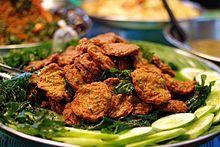 Thot man pla krai, served with fried basil