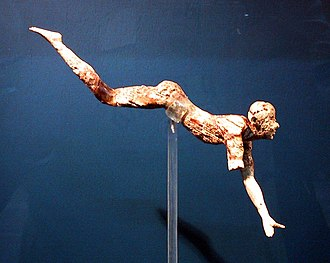 Bull-leaping - The bull-leaper, an ivory figurine from the palace of Knossos, Crete. The only complete surviving figure of a larger arrangement of figures. This is the earliest three dimensional representation of the bull leap. It is assumed that thin gold pins were used to suspend the figure over a bull.