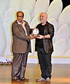 The Chief Minister of Goa, Shri Digambar Kamat presenting the Best Actor Award to Mr. Guven Kirac , for the film 'the Crossing', during the closing ceremony of the 41st IFFI-2010, at Panaji, Goa on December 02, 2010.jpg