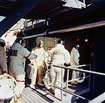 The three Apollo 14 astronauts arrive at the White Room atop Pad A.jpg