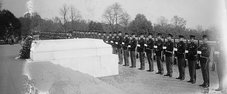 Tomb of the Unknown Soldier, Arlington National Cemetery, on 11 November 1922. View is of the south side of the Tomb looking north. Was replaced in 1931 by the present marble Tomb