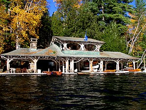 Great Camps - The twig work boathouse at Camp Topridge.
