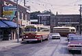 Toronto CCF-Brill trolleybus passing PCC streetcar on Oakwood St, 1968.jpg