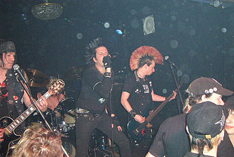 Punk fashion - Anarcho-punk band Total Chaos in all-black clothing