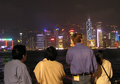 Tourists in front of Victoria Harbour.png