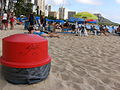 Trash cans line the beach front at Royal Hawaiian in Waikiki.JPG