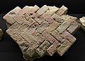 Tros del terra del caldari format amb rajoles disposades en espiga, Lucentum, MARQ.JPG