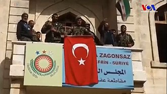 Afrin Canton - Turkish soldiers and TFSA fighters at the building in Afrin that had hosted the PYD-led government of the region, 18 March 2018