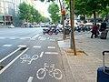 Two-way bikeway turns the corner between motorcycle parking and curb (18605406670).jpg