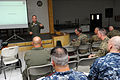 U.S. Air Force Brig. Gen. James F. Mackey, standing, a mobilization assistant to the director of operations, plans and policy for Pacific Air Forces, speaks to a group of Balikatan 2013 participants during 130406-F-HL283-106.jpg
