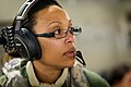 U.S. Air Force Capt. Belinda Rice, a flight nurse with the 34th Aeromedical Evacuation Squadron, Peterson Air Force Base, Colo., listens to feedback from an observer-controller-trainer during a flight aboard 140313-F-XL333-437.jpg