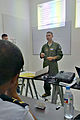 U.S. Air Force Maj. Steve Payne, an intelligence, surveillance and reconnaissance (ISR) mission planning instructor with U.S. Air Forces in Europe and Air Forces Africa, instructs students on ISR mission 140902-F-FV908-007.jpg