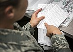 U.S. Air Force Senior Airman Megan Stanton, a medic with the 366th Medical Operations Squadron, reviews index cards covered in medical terminology in the urgent care center at Mountain Home Air Force Base 130715-F-NW635-195.jpg